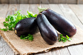 Fresh eggplant on wooden background