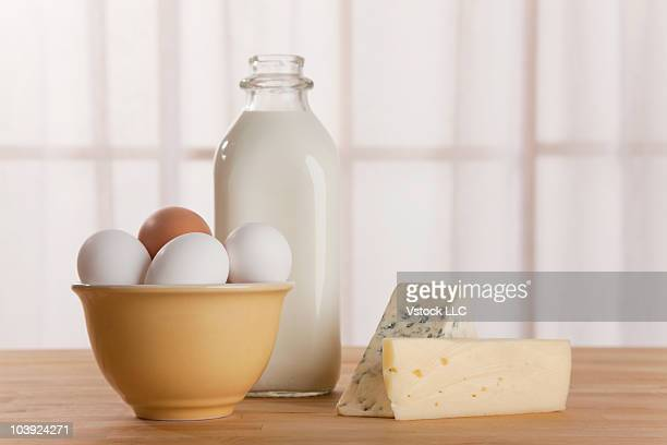 Fresh eggs cheese and milk on counter