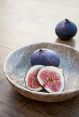 Fresh figs in wooden bowl