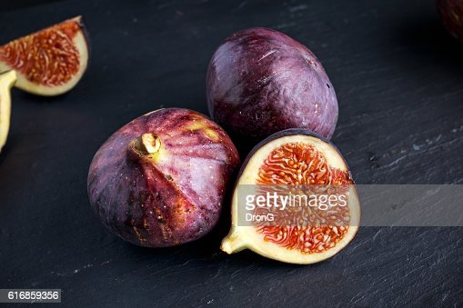 Fresh Figs slice on black stone board : Stock Photo