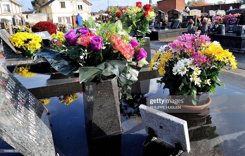 Fresh flowers are seen on October 30, 2012 at the Oignies cemetery, northern France, two days before the traditional November 1 All Saints religious feast.