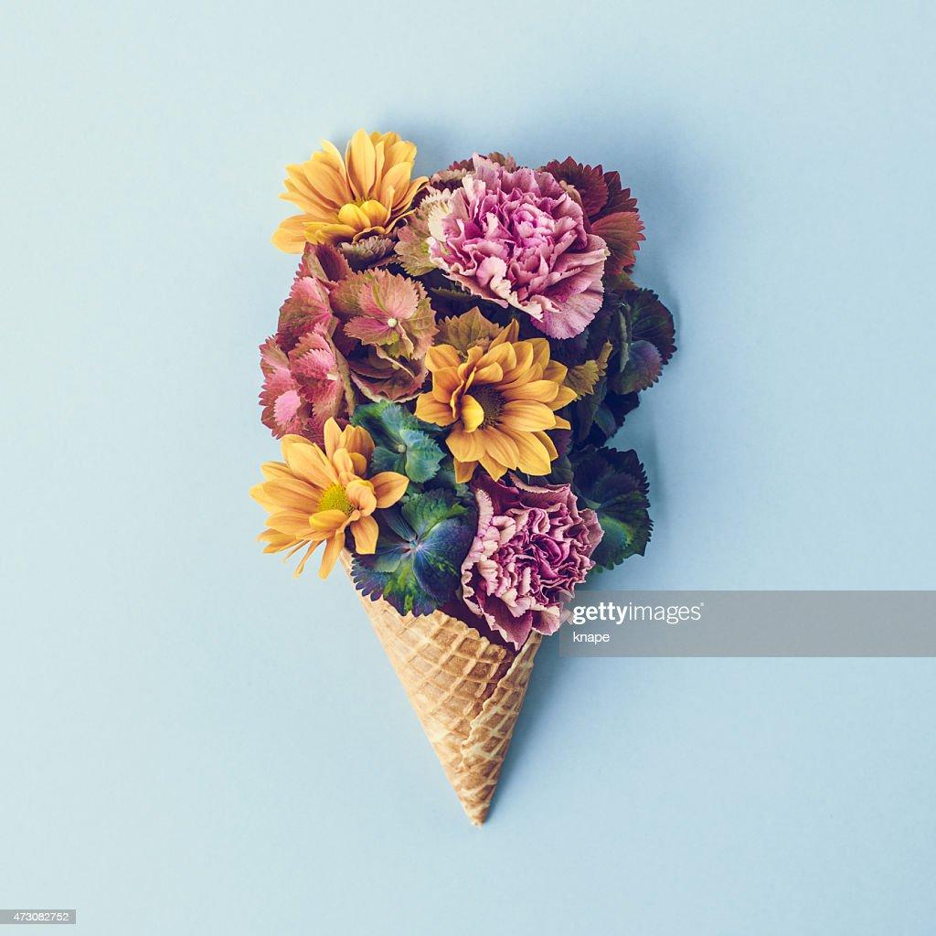 Fresh flowers in ice cream cone still life : Stock Photo