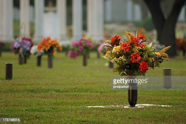 Fresh flowers in vases at a cemetery
