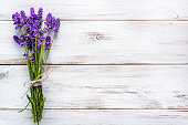 Fresh flowers of lavender bouquet, top view on white wooden background