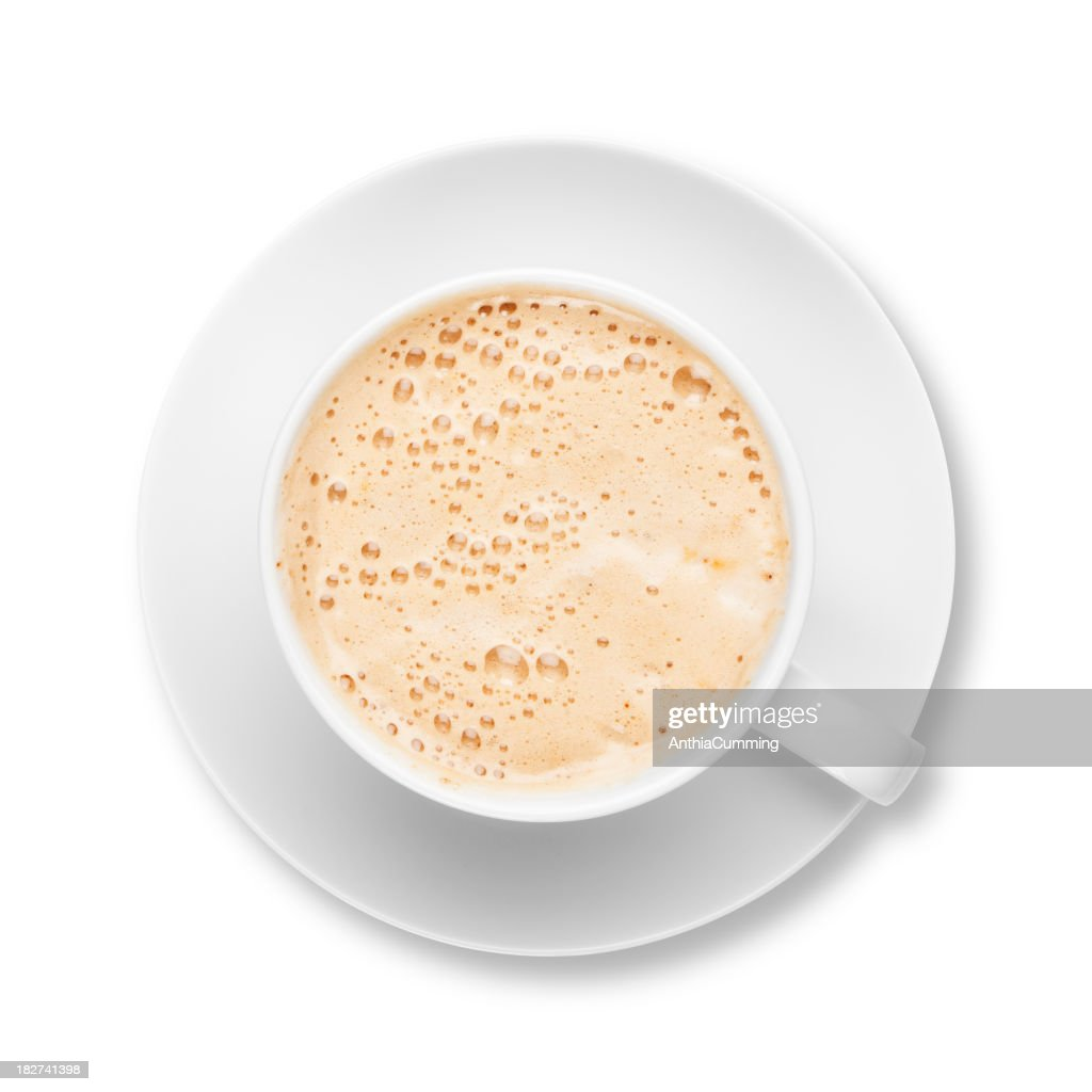 Fresh frothy latte coffee in white cup with saucer : Stock Photo