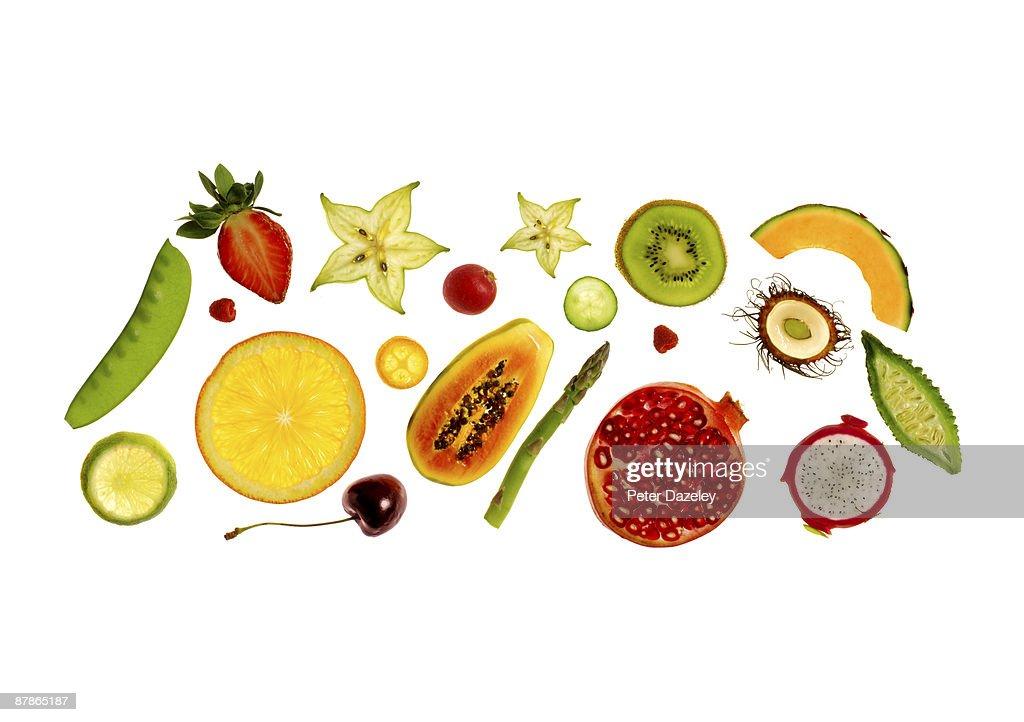 Fresh fruit and vegetables on white background.