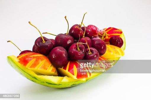 fresh fruit on creative bowl in isolated background : Stock Photo