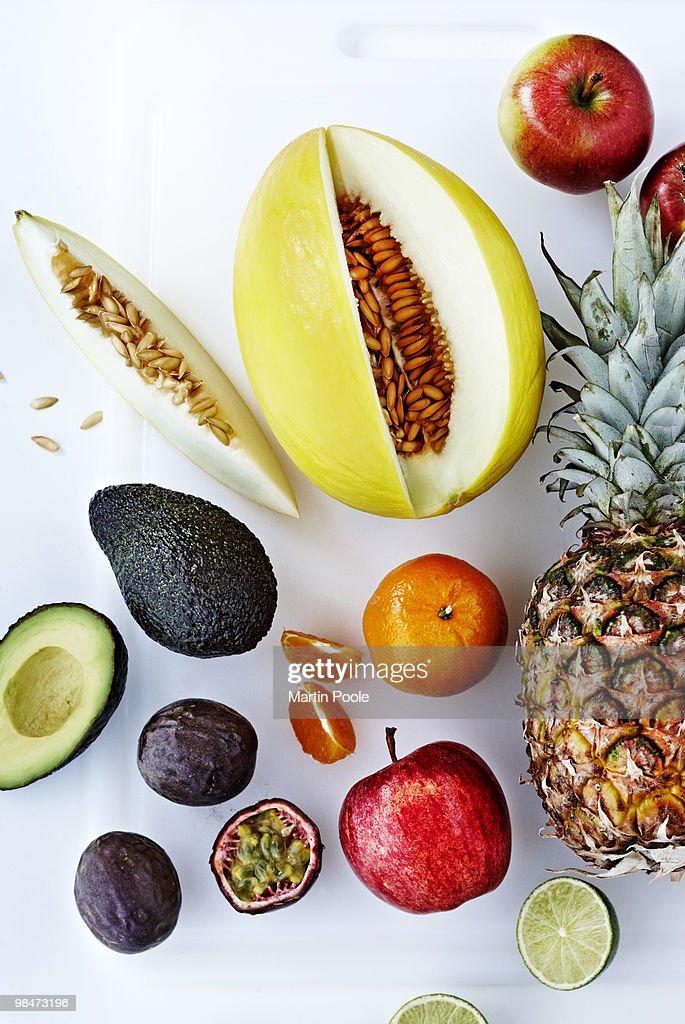 fresh fruit overhead on white chopping board