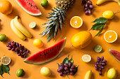 Fresh fruit on yellow background