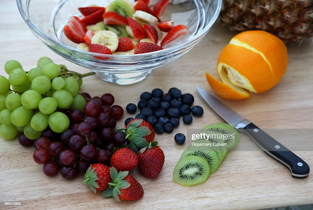 Fresh fruit salad in preparation. : Stock Photo