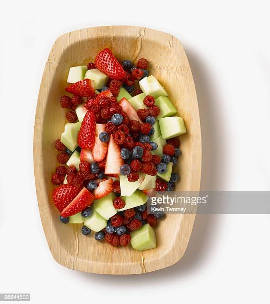 Fresh fruit salad in wooden bowl