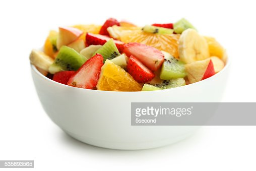 Fresh fruit salad isolated on white : Stockfoto