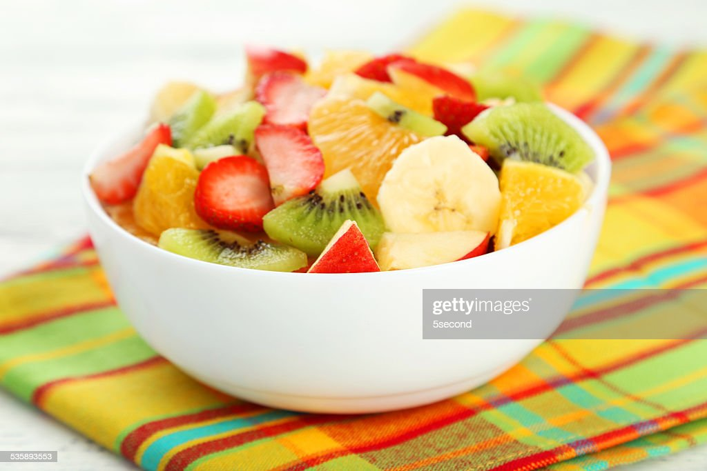 Fresh fruit salad on white wooden background : Stock Photo