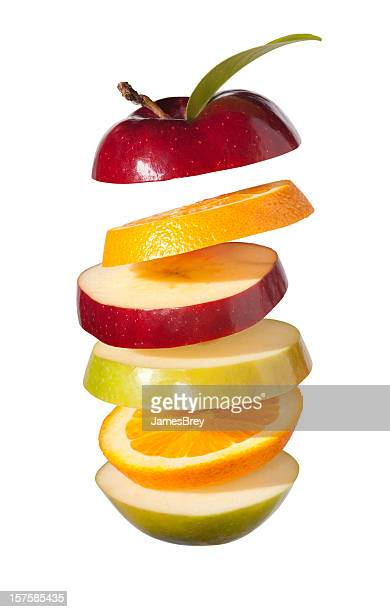 Fresh Fruit Slices; Apples and Oranges on White Background