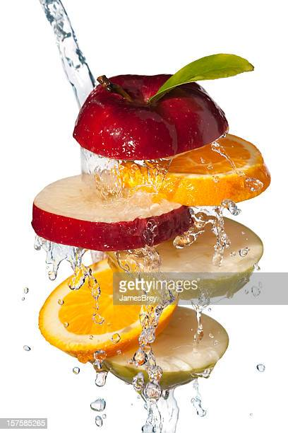 Fresh Fruit Slices Tossed in Cool Water, White Background