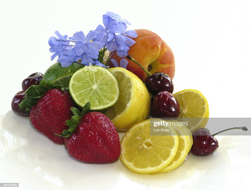 Fresh Fruits and Flowers on White : Stock Photo