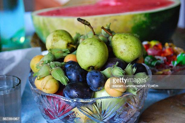 Fresh Fruits In Bowl On Table
