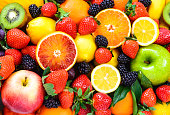 Fresh fruits background.Colorful organic fruits background.