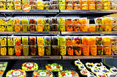 Big shelf in supermarket with fresh fruits