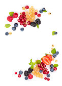 Frame of  fruits and berries with leaves.  Isolated on white background.