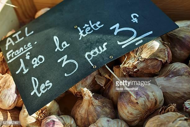 Fresh garlic on French market stall, close-up