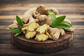Fresh ginger root on the wooden table
