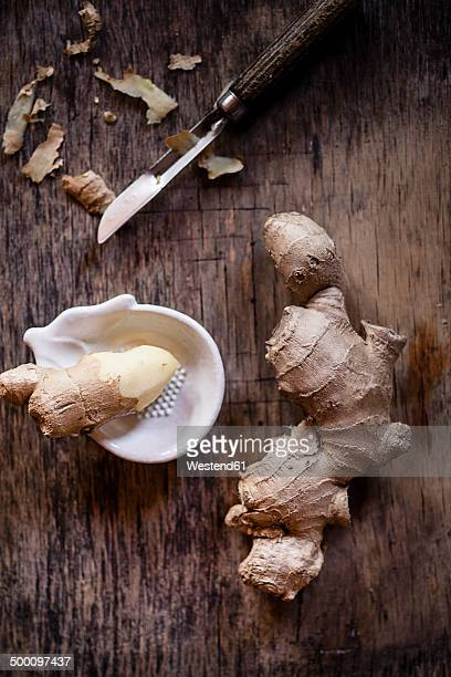 Fresh ginger with peeler and grater