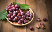 fresh grape on dark wood background, top view white copy space
