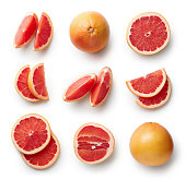 Set of fresh whole and cut grapefruit and slices isolated on white background. From top view