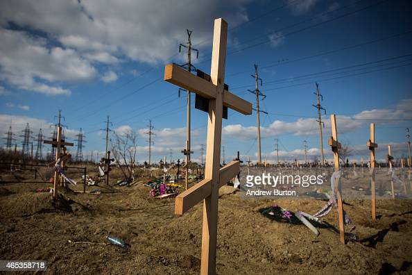 Fresh graves many of which have been created due to the ongoing conflict between Ukraine and proRussian rebels sit on a hillside on March 6 2015 in...