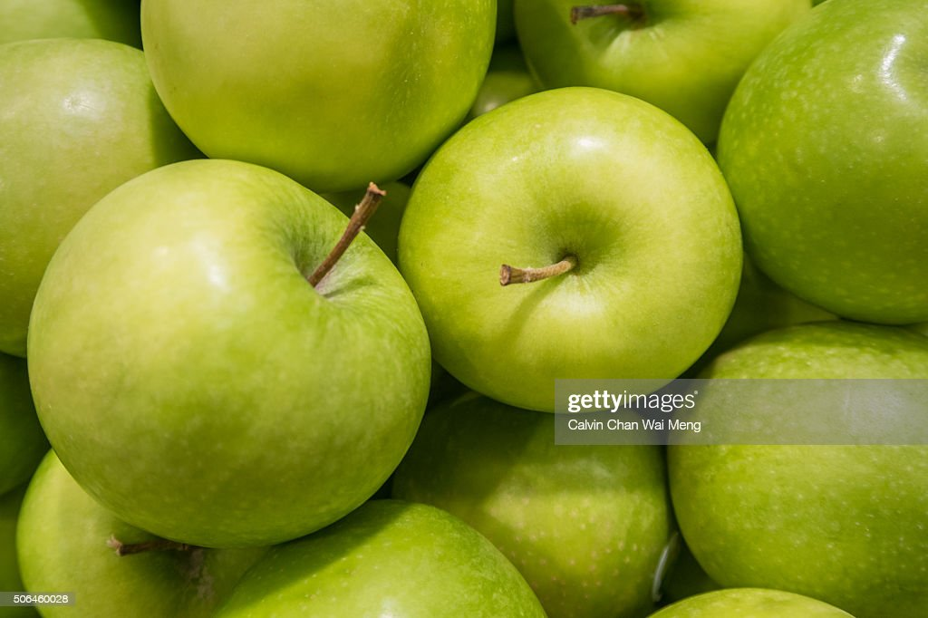 Fresh green apples for sale in supermarket