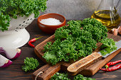 Fresh green kale with olive oil and spices, ready for cooking, selective focus
