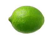 Fresh Green Lime photographed pretty much straight on from a side view.  Lime is a rounded citrus fruit similar to a lemon, but greener, smaller, and with the distinctive acid flavor.  It is grown fr