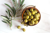 Fresh green olives on the white painted background