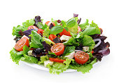 Fresh green salad on white background.