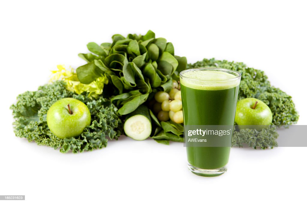 Fresh greens and fruits used to make a smoothie