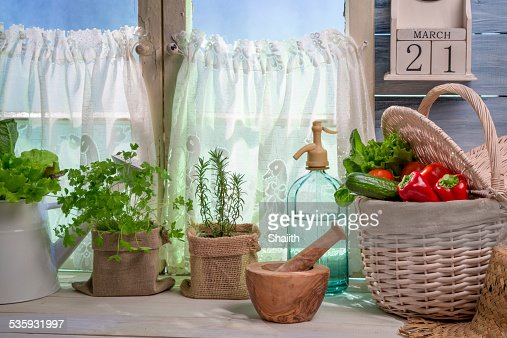 Fresh herbs near white window : Stock Photo
