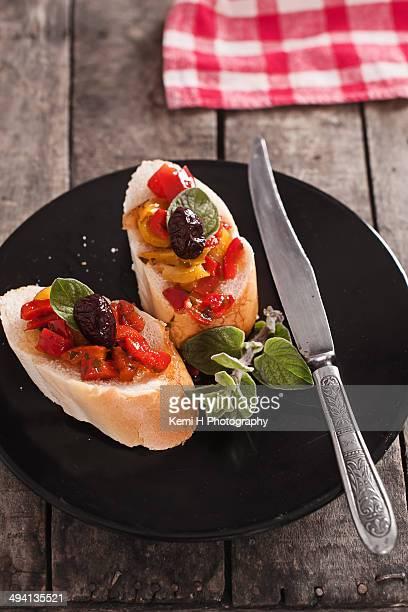 Fresh homemade brushetta with peppers and oregano