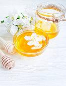 fresh honey, blooming apple tree, wooden background