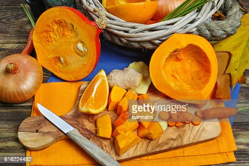 Fresh ingredients for pumpkin soup - apple, orange, carrot, onion : Stock Photo