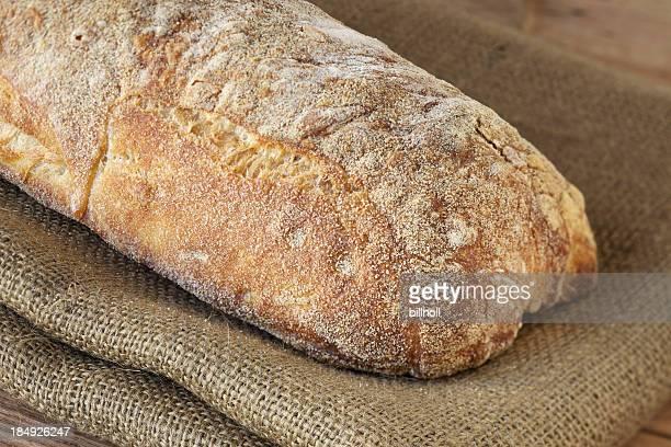 Fresh Italian ciabatta bread on brown burlap