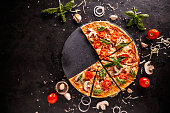 Fresh Italian pizza with mushrooms tomatoes and cheese, space for your text