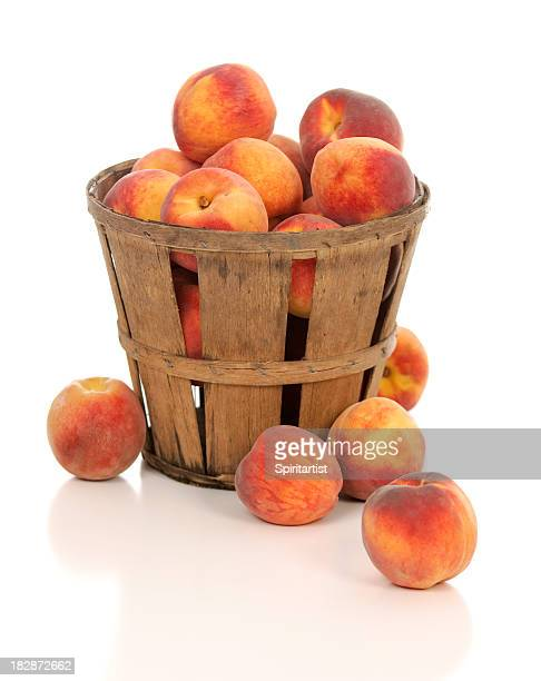 Fresh Juicy Peaches in a Rustic Farm Basket