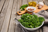 Fresh kale with olive oil, garlic and pepper, selective focus, copy space
