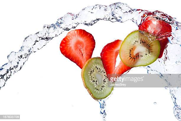 Fresh Kiwi, Strawberry Slices Tossed With Water on White Background