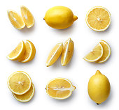 Set of fresh whole and cut lemon and slices isolated on white background. From top view