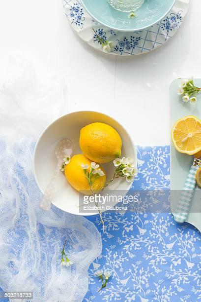 Fresh lemons and white flowers