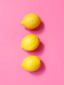Lemons isolated on pink background