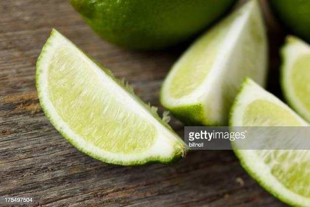Fresh lime slices on farm table