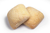 Two fresh loaves of ciabatta against a white background. Italian bread
